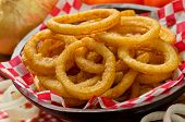 image of fried onion  - A serving of delicious breaded and deep fried golden brown onion rings - JPG