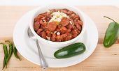 pic of jalapeno  - A bowl of red beans and rice with spicy green jalapeno peppers - JPG