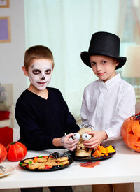 foto of eye-sockets  - Photo of twin boys holding spooky eyes just in skull eye - JPG