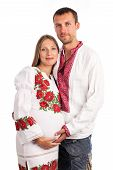 Young couple in Ukrainian style clothing on white