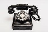 stock photo of rotary dial telephone  - Vintage telephone with rotary dial on a white background - JPG