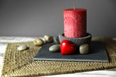 pic of funeral home  - candle in a candlestick and a red stone heart  - JPG