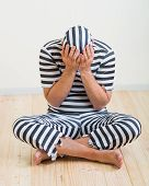 foto of repentance  - portrait of a repentant man prisoner in prison garb - JPG