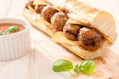 pic of meatball  - Tasty sandwich stuffed with meatballs and tomato sauce - JPG