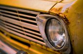 stock photo of muscle-car  - Retro Filter Photo Of A Damaged Vintage Seventies Car
