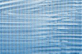 foto of suds  - abstract texture of soap suds of blue color on a striped dark background - JPG