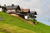 Alpine Chalets On Hill. Summer Time