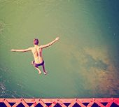 stock photo of trestle bridge  - a boy jumping of an old train trestle bridge into a river done - JPG