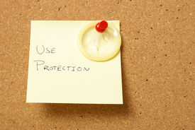 picture of lube  - A message board reminds us to use protection for safe sex - JPG