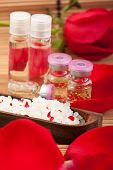foto of swedish sauna  - rose petals rose extract bottles and bathing salt - JPG