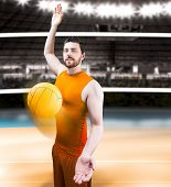 stock photo of volleyball  - Volleyball player on orange uniform on volleyball court - JPG
