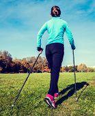 stock photo of pole  - Vintage retro effect filtered hipster style image of nordic walking adventure and exercising concept  - JPG