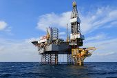 picture of drilling platform  - Offshore Jack Up Drilling Rig Over The Production Platform in The Middle of The Sea - JPG