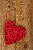 foto of heartfelt  - Red heart on a wood background  - JPG