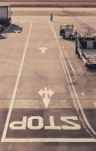 image of truck-stop  - Stop sign on Road at Airport Runway with Truck - JPG