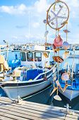 stock photo of dreamcatcher  - The dreamcatcher decorated with the shells and starfish in port of Latchi Cyprus - JPG