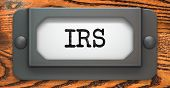 stock photo of irs  - IRS Inscription on File Drawer Label on a Wooden Background - JPG