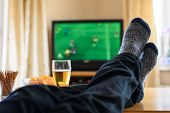 Television, Tv Watching (football Match) With Feet On Table And Huge Amounts Of Snacks poster