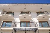 pic of wrought iron  - Facade of a hotel building with wrought iron balconies in city Balchik Bulgaria - JPG