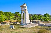 stock photo of epidavros  - The archaeological site of the Sanctuary of Asclepius with the ruins of Asclepius Temple Epidavros Greece - JPG