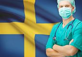 picture of sweden flag  - Surgeon with national flag on background  - JPG