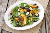 pic of vinegar  - Plate of grilled peach and Mozzarella salad with mixed baby greens and balsamic vinegar in a rustic setting - JPG