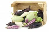 picture of wooden crate  - fresh mixed aubergines - JPG