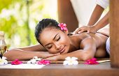 image of therapist massage  - Woman having relaxing Asian massage in spa salon - JPG