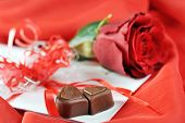 stock photo of rose close up  - beautiful rose chocolate and letter on red close up  - JPG