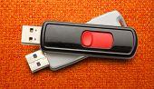 stock photo of usb flash drive  - Usb flash drives on the cloth background - JPG