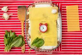 stock photo of lasagna  - Making of tasty Italian lasagna on a bright background - JPG
