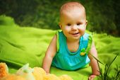 foto of baby toddler  - Funny Toddler Baby Girl playing in the Park - JPG