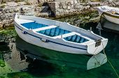 picture of old boat  - Old white wooden boat in Perast Montenegro - JPG