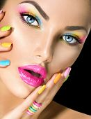 pic of colore  - Beauty Girl face with Vivid Makeup and colorful Nail polish - JPG