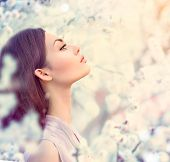 stock photo of romantic  - Spring fashion girl outdoor portrait in blooming trees - JPG