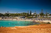 image of sunbather  - people sunbathing and swimming at the famous Nissi beach in Cyprus - JPG