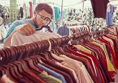 pic of thrift store  - Young man buying in second hand store - JPG