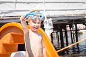 image of little boys only  - Joyful little boy near a playground, beach vacation with his parents.