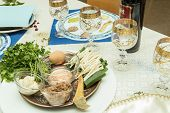 foto of passover  - seder table with passover plate and special meal with egg parsley - JPG