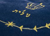 stock photo of rabbi  - blue tallit bag with embroidery Hebrew tallit close up - JPG
