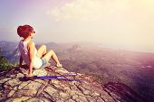 picture of cliffs  - woman hiker enjoy the view at sunset mountain peak cliff - JPG