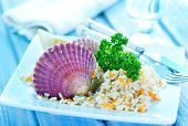stock photo of scallops  - rice with scallop on plate and on a table - JPG
