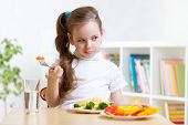 foto of healthy eating girl  - pretty kid girl refusing to eat her dinner healthy vegetables - JPG