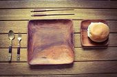 picture of bread rolls  - A square wooden place setting with a bread roll  - JPG