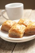 picture of baklava  - baklava close up in white plate with cup of coffee - JPG