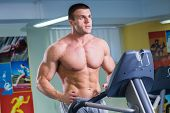 image of treadmill  - Man in the gym - JPG