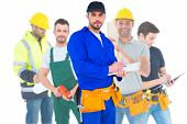 image of overalls  - Composite image of handyman in blue overall writing on clipboard - JPG