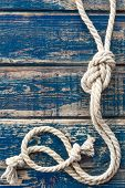 image of marines  - Vintage wooden background with knotted marine rope - JPG