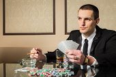 picture of poker hand  - Poker player - JPG
