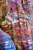 foto of petra jordan  - Abstract colorful patterns in sandstone cliff of world wonder Petra Jordan - JPG